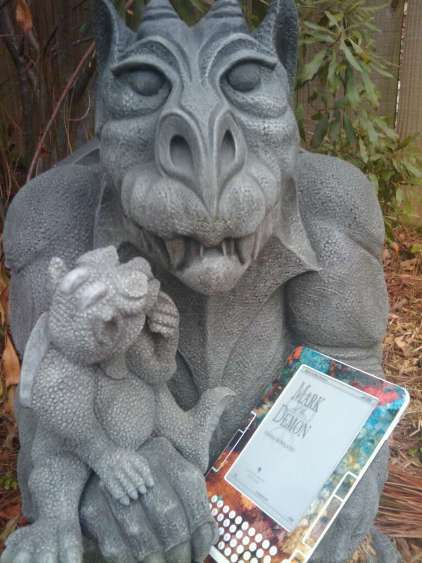 Awww... daddy demon is reading to baby demon!